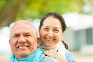 happy couple with hearing aids